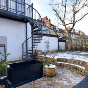garden and spiral staircase